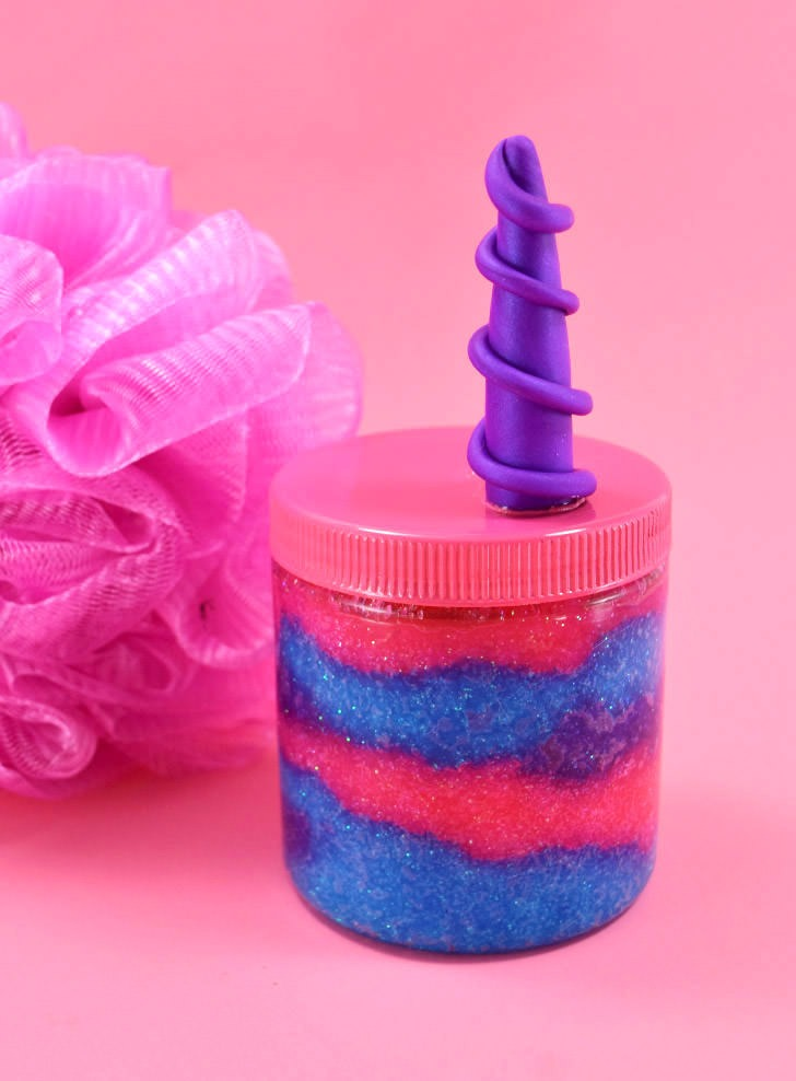 This unicorn sugar scrub is glittery, luxurious and totally easy to DIY. Learn how to make a clay unicorn horn, too!