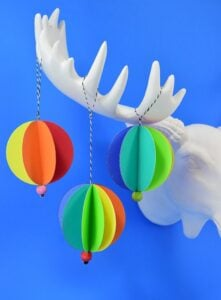 These rainbow paper ornaments are such an easy decoration for a fun and colorful Christmas tree! Make them in minutes and stash bust at the same time!