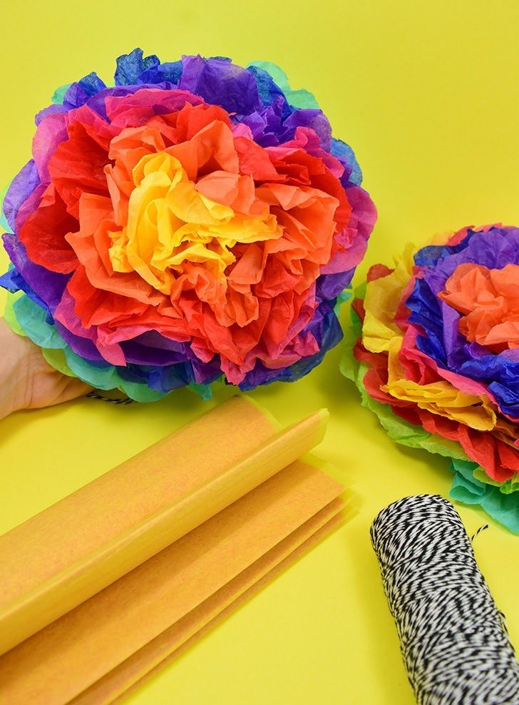 Tissue paper pompoms dream a little bigger can you believe these gorgeous flower pompoms are made out of tissue paper simple to mightylinksfo Choice Image