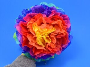 Can you believe these gorgeous flower pompoms are made out of tissue paper? Simple to make and super cheap these tissue paper pompoms are a super craft!