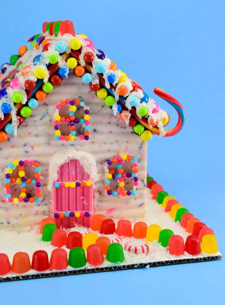 """Is this not the sweetest little Christmas thing you've ever seen? These chocolate """"gingerbread"""" style candy houses are perfect for the holidays. They can easily be gluten free, too!"""