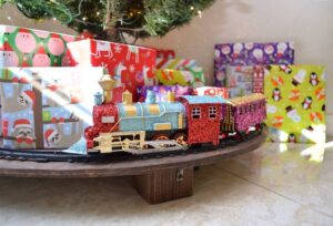 How neat is this? Put a train around the tree and keep it (and gifts) off of the floor! I love this!