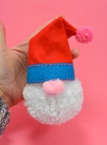 Some yarn and felt will make the cutest pompom gnomes. Great as fun decor items or Christmas ornaments!