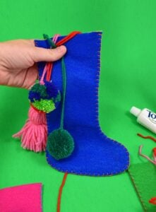 These small felt stockings use only one sheet of acrylic craft felt but they're so adorable! They're perfect for little things and toiletries!