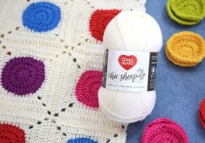 I love modern crochet patterns! This take with a colorful circle encased in white is modern and so fun. Who knew a circle granny square could look so cool!