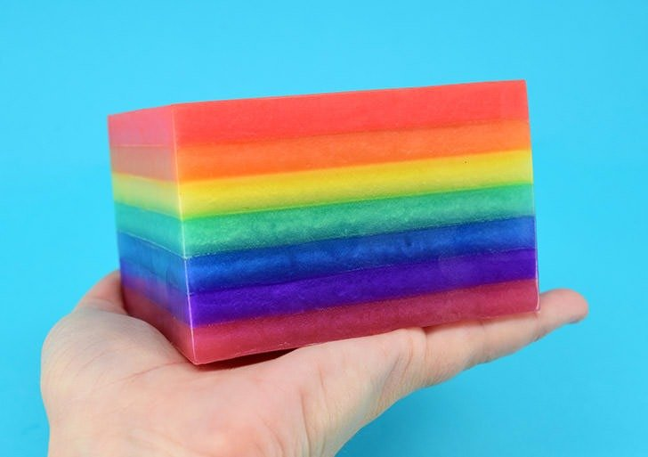 Wondering why your soap is peeling apart? Check out this tutorial for how to layer soap for the super easy fix and make some fun rainbow soap, too!