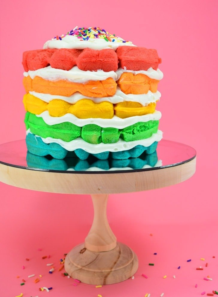 Want the perfect birthday breakfast? Check out this awesome waffle maker layered rainbow cake that is super easy to make and won't heat up the kitchen!