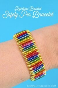 Can you believe this colorful bracelet is made out of safety pins? No jewelry making tools needed to make this fabulous rainbow beaded safety pin bracelet!