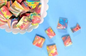 This white chocolate fudge recipe is tinted and marbled to make the prettiest tie dye fudge around! Impress your guests without them knowing you didn't even have to break out the candy thermometer!