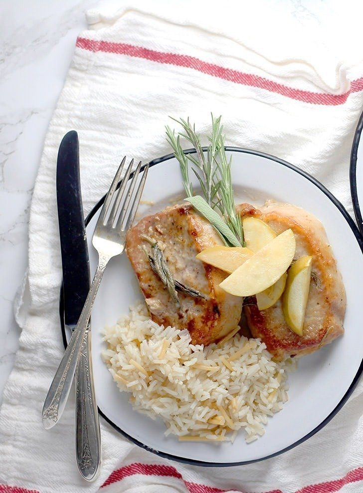 These pork chops are lightly breaded and finished off with sauteed apples, onions and a creamy sage sauce. It is seriously AMAZING!!!