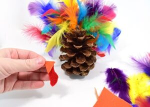 Gobble! Gobble! Decorate your Thanksgiving table with this fun pine cone turkey craft perfect for little hands!