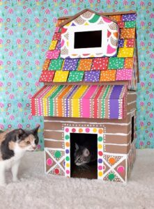 My cat LOVES hiding in boxes. I'm going to make her this gingerbread cat house. All I really need are boxes already in the garage, some paint and a craft knife. LOVE IT!