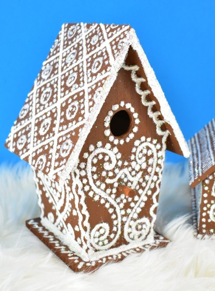This is genius! these faux gingerbread birdhouses are cute, glittery and can be stored and pulled out for my Christmas decor next year!