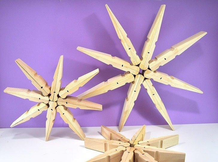 Absolutely massive clothespins make the most perfect, 20 inch giant clothespin snowflakes that will be the glittery envy of all of your holiday guests!
