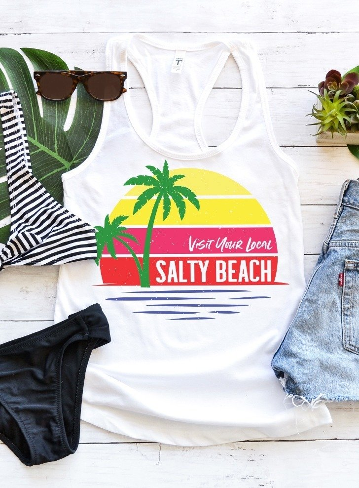 With a cool vintage vibe, this Visit Your Local Salty Beach tee shirt is sure to be a hot new staple to your summer wardrobe. Get the free SVG file to make your own!