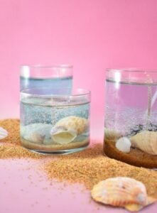 Add a lovely beach-inspired touch to your home decor turning your ocean vacation finds into gorgeous DIY seashell candles.