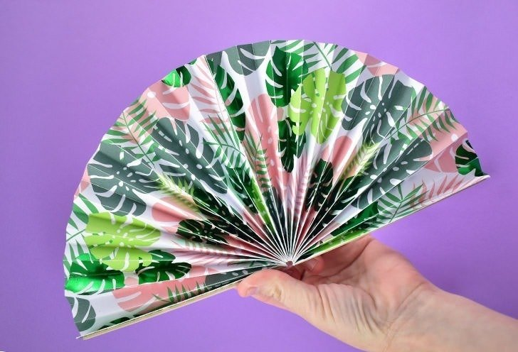 Turn pretty cardstock into gorgeous and super effective folded paper fans that are great to tuck in your purse for those hot days!