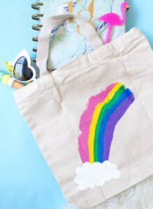 Fun rainbow paint scrape tote bag for back to school with tutorial by Club Crafted.