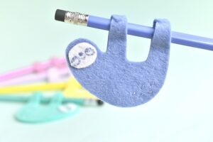 Adorable back to school kid craft pencil sloths by Handmade Charlotte.