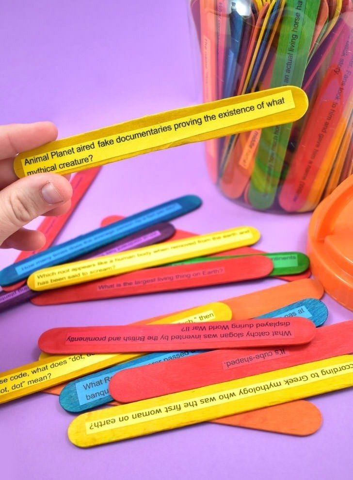 Make a super fun and easy DIY popsicle stick trivia game using whatever genres or categories you please! Plus it easily travels for fun on the go!