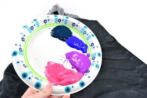 Using a paper plate or plastic palette, squeeze out a healthy amount of each color you will be painting your galaxy in.