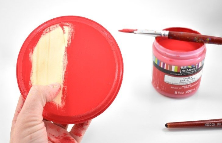 To make DIY giant checkers, paint 12 wooden plaques your first color, and then the remaining 12 with your second color.