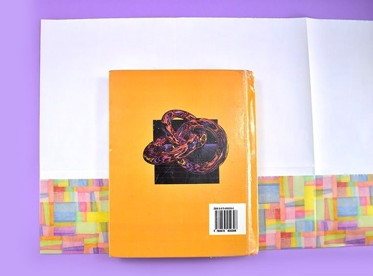 To make a protective book cover for text books you don't need any tape or special tools, just your hands and scissors!