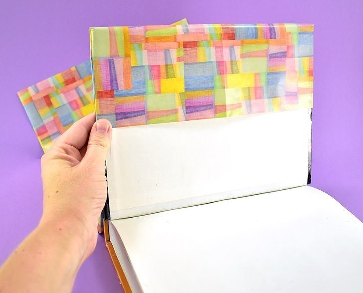 Pull the paper down until you reach the crease that you created just a bit ago.