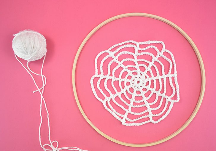 Crochet spider webs should be smaller than your wood embroidery hoop. If using multiple hoops make your webs varying sizes for an interesting visual look.