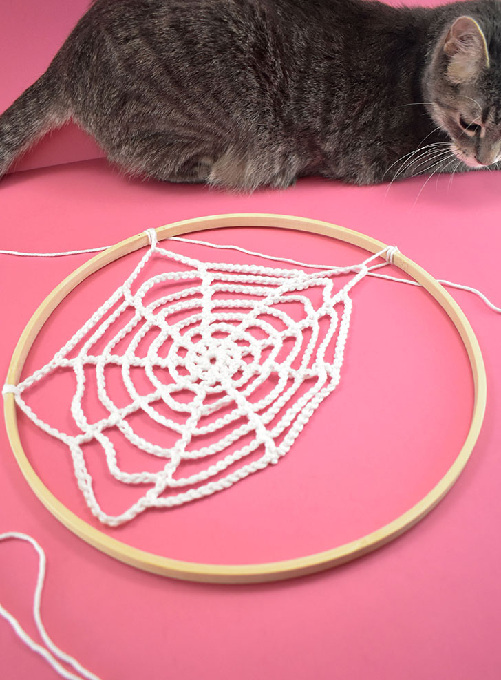 Attach webs to hoops using small pieces of yarn and hot glue.