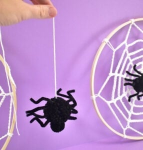 Create a dangling spider for your embroidery hoop spider webs.