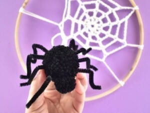 Isn't this pompom spider adorable? He dangles from the cutest embroidery hoop spider web and I just love it!