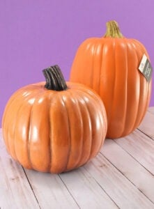 Make fake pumpkins look real! The one in the front has been DIYed to be a realistic fake pumpkin while the original in the back just looks plain fake!