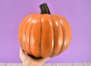 Looking for realistic pumpkins? It is totally possible to make fake pumpkins look real and all it takes is a few layers of paint!