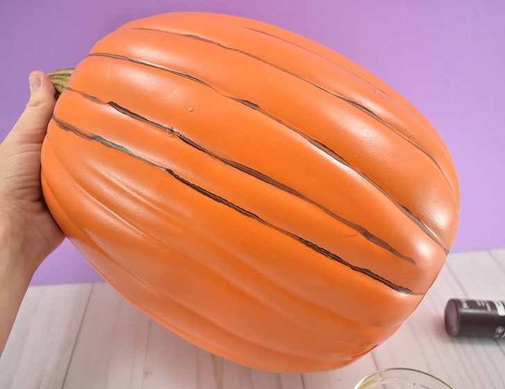 Paint thin lines around the entire pumpkin in the seams.