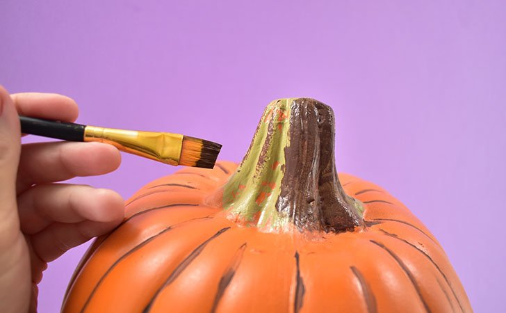 Apply a thick coat of brown paint to the stem, pushing it into any nooks, crannies and imperfections.