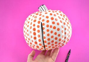 Draw lines of varying thickness and shape along the lines in the pumpkin that divide the sections.