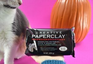 The best clay I found to make your own fake knucklehead pumpkin is Creative Paperclay.