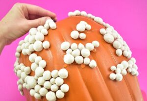 Work around and around gluing all of your clay to your warty pumpkin.
