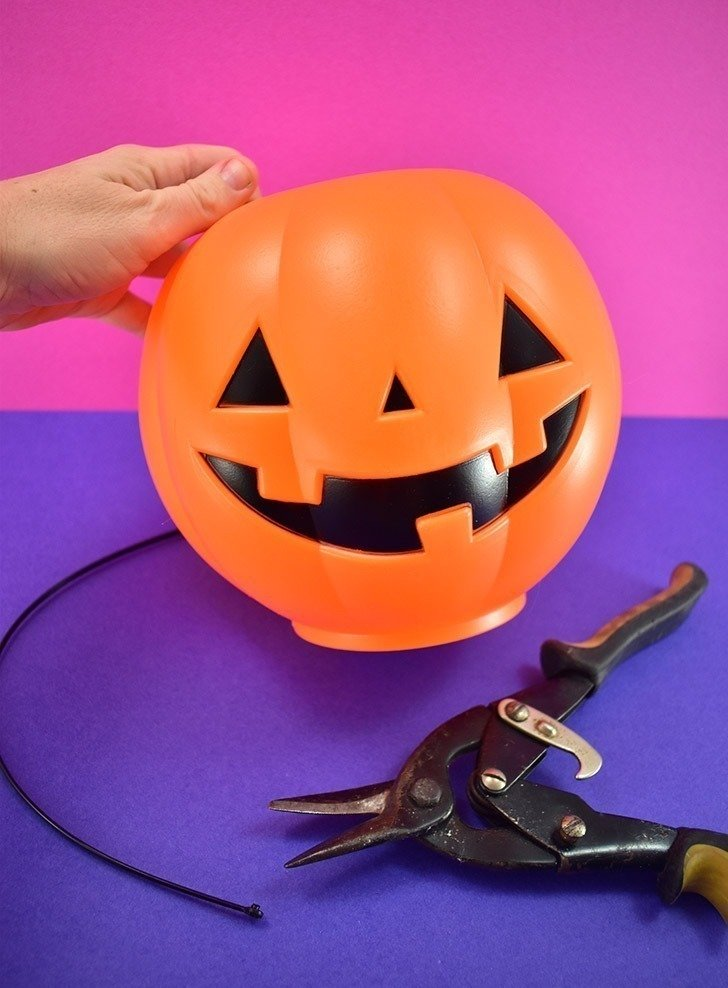 Remove the handles from your pumpkin pail.