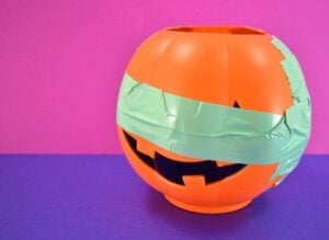 Apply tape around the pumpkin horizontally to hold everything tightly together.