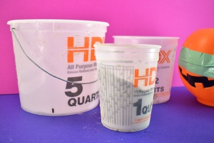 Prepare 3 plastic paint tubs to mix your cement.