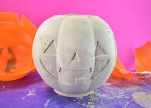 Pull the face of the pumpkin pail away from the cement pumpkin very last.
