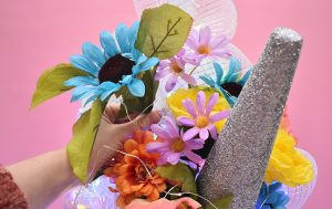 Trim the individual flowers from your artificial bouquet and place into the tree around the top and sides of the horn.