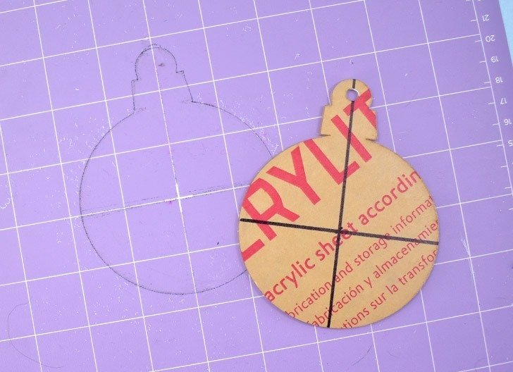 If you're happy with the placement of the engraving on your ornament BEFORE YOU REMOVE IT FROM THE MAT, use a fine point market to trace around the entire shape.