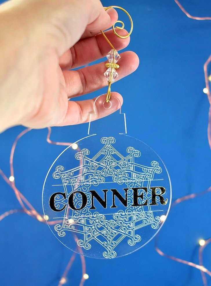 These DIY Engraved Christmas ornaments are gorgeous and super simple with our free Cricut Design Space Files. Make your own engraved ornaments today!