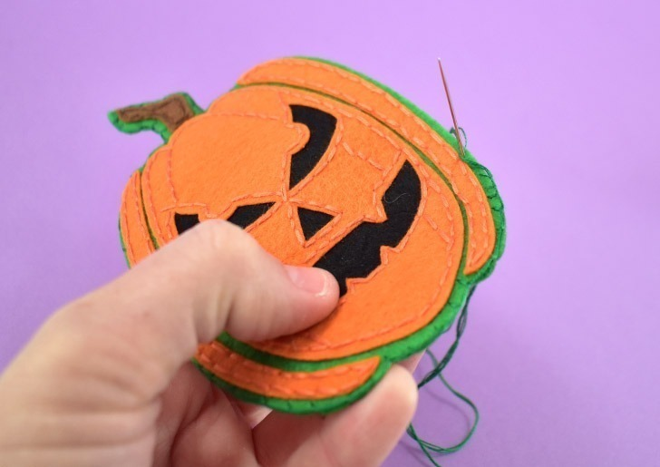 Continue stitching around the sides to close up completely.