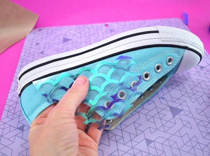Cut interesting shapes out of different fish scales and place them as you'd like on the sneaker's canvas.