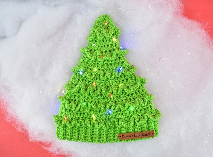 Looking for an adorable crochet hat to keep heads warm and celebrate the Christmas season? Get this adorable, FREE Christmas Tree Hat Crochet Pattern!