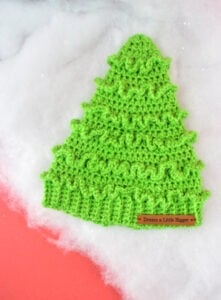 Looking for an adorable crochet hat to keep heads warm and celebrate the Christmas season? Get this adorable, FREE Christmast Tree Hat Crochet Pattern!